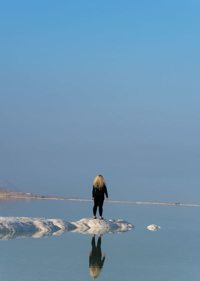 Minimalist reflect day At The Lowest Place On Earth -416 meters below sea level -Deadsea Israel Beauty In Nature Blue And White Clear Sky Golden Hour Minimalism Minimalist Nature One Person One Woman Only Rear View Reflection Reflections Salt Saltwater Tranquil Scene Tranquility Water Finding New Frontiers EyeEm Team Getty X EyeEm Minimal Planet Earth Traveling Home For The Holidays Miles Away Long Goodbye Perspectives On Nature