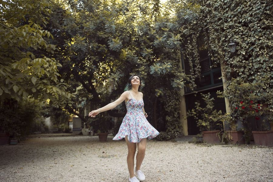 EyeEm Selects Tree Full Length Only Women Outdoors One Person Fun Young Adult Carefree Adult Adults Only One Woman Only Young Women Smiling People Day Nature One Young Woman Only Sky Travel Destinations Italy Italia City Swirl Sundress