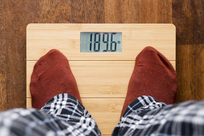 Man on bathroom scale Bathroom Scale Body Scale Diet Human Body Part Human Leg One Person Overhead View Overweight Point Of View Pounds Pyjama Socks Weight Weightloss