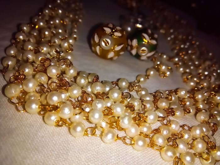 Jewelry Wealth Gold Colored Gold Luxury Elégance Fashion Necklace Precious Gem No People Indoors  Gemstone  Shiny Close-up Large Group Of Objects Pearls Jewelr Pearls Pearl Necklace  Jewellery💎 Jewelleryaddict Macro Photography Macro_collection