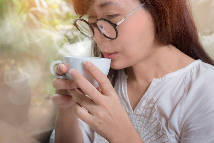 Close-Up Of Woman Having Coffee