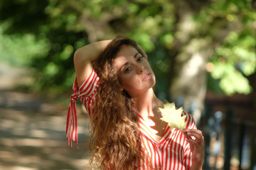 summer stroll model Julia Bond Adult Beautiful Woman Beauty Brown Hair Contemplation Day Focus On Foreground Hair Hairstyle Long Hair Looking Looking At Camera One Person Outdoors Portrait Teenager Tree Women Young Adult Young Women