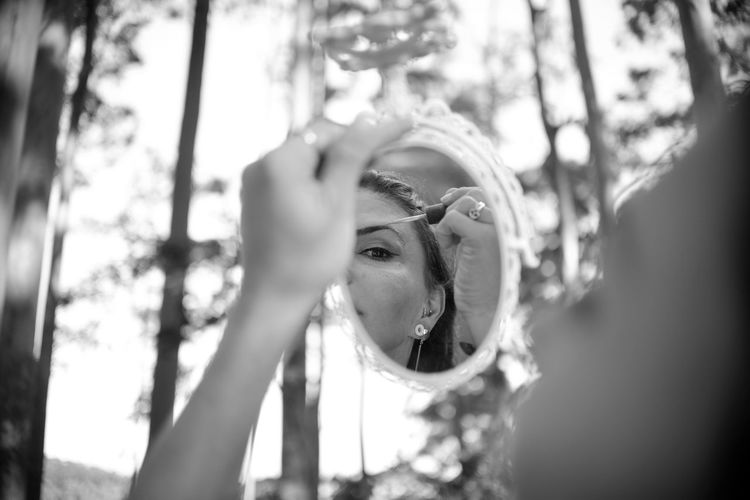 The Portraitist - 2019 EyeEm Awards EyeEm Best Shots Eye4photography  Getting Inspired My Best Photo ExploringBrazil Eucaliptus Forest Wandering Headshot Portrait One Person Real People Leisure Activity Tree Lifestyles Day Plant Young Adult Front View Looking Focus On Foreground Young Women Selective Focus Reflection Nature Mirror Outdoors Human Face Blackandwhite Monochrome Makeup Eucalyptus