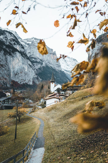 the last leaves in Lauterbrunnen – autumn in Switzerland Mountain Beauty In Nature Nature Scenics - Nature Tranquility No People Tranquil Scene Mountain Range Tree Outdoors Autumn Church Mountain View Mountain Road Village Old Town Switzerland Valley Leading Old Old Buildings Cold Temperature Day