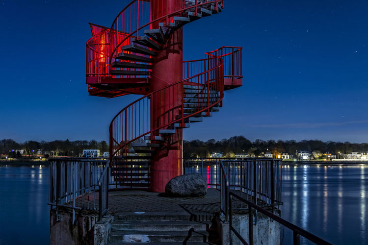SpiralStaircase Architecture Blue Blue Sky Bridge Bridge - Man Made Structure Built Structure Connection Elbe River Finkenwerder Illuminated Nature Night Photography No People Outdoors Railing Red River Sky Spiral Staircase Tranquility Travel Destinations Water Water Reflections