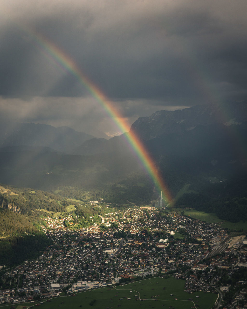 AERIAL VIEW OF RAINBOW OVER CITYSCAPE