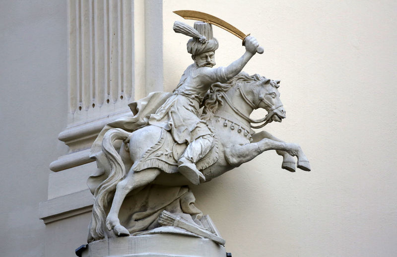 Horseman, Architectural artistic decorations on facade of house in Vienna, Austria Architecture Art Austria Austrian Baroque Built Capital City Column Cross Culture Day Europe Heritage Historic Historical History Old Sculpture Statue Style Symbol Traditional Urban Vienna Stucco Horseman House Art And Craft