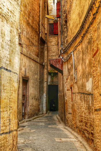 Narrow alley amidst old building