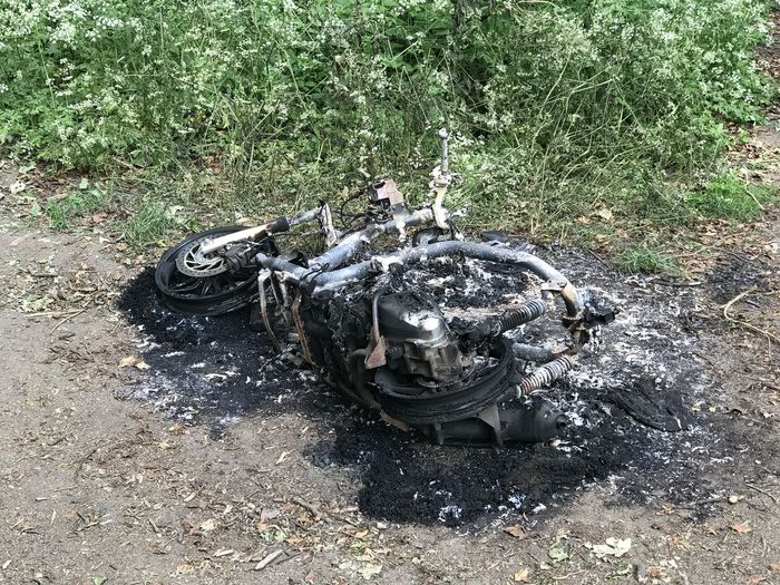 High angle view of abandoned motorcycle on field