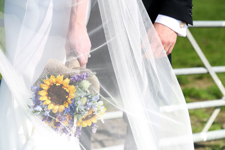 Rural Wedding Rural Scene Countryside Somerset Bride And Groom Bride Love Farm Flower Flowering Plant Wedding Plant Newlywed Real People Nature Holding Wedding Dress Midsection Life Events Event Bouquet Celebration Flower Arrangement Women Adult Day Human Hand Hand Wedding Ceremony Outdoors Couple - Relationship Wedding Rings Flowers Wedding Flowers
