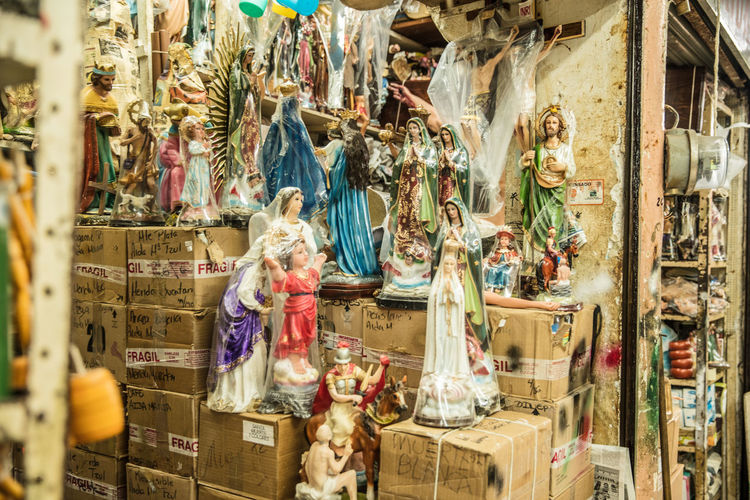 Statues in store for sale in market