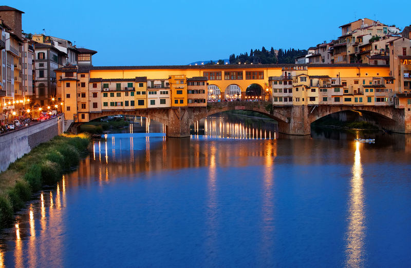 Ponte Vecchio Over Arno River In Tuscany Against Sky At Dusk