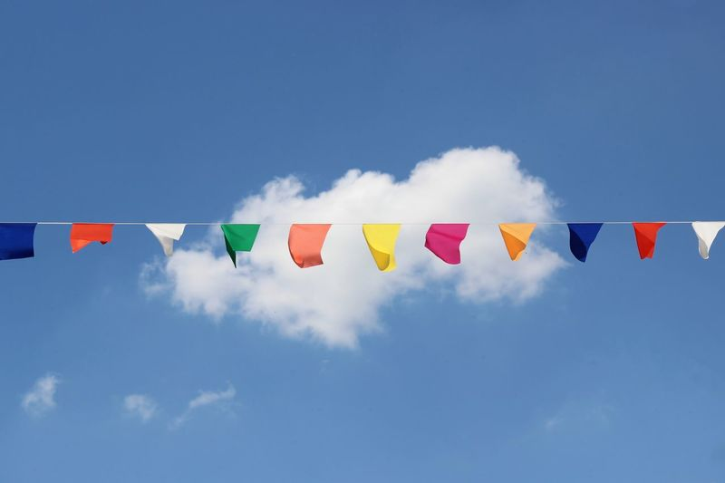 Sky Multi Colored Cloud - Sky Flag No People Nature Blue Low Angle View Day Bunting Patriotism Celebration Wind String Side By Side Variation Choice Environment Outdoors Hanging