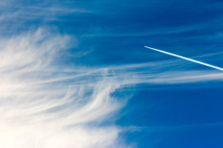 Aerial view of vapor trails in sky