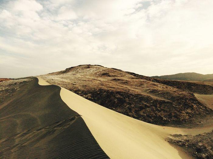 Desert against cloudy sky