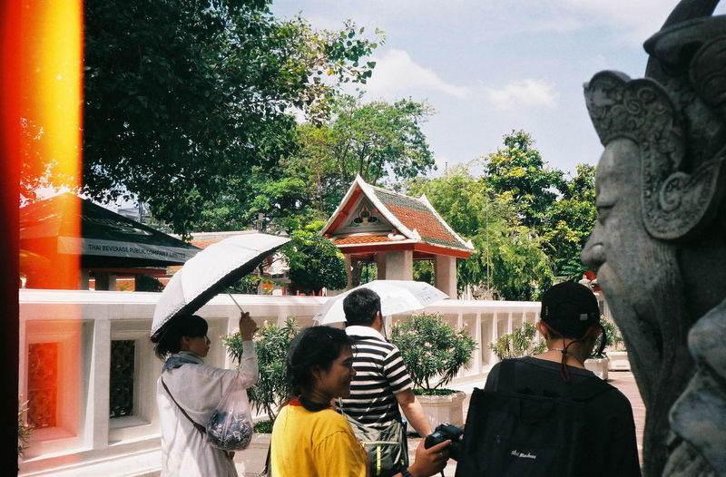 Rear view of people outside temple