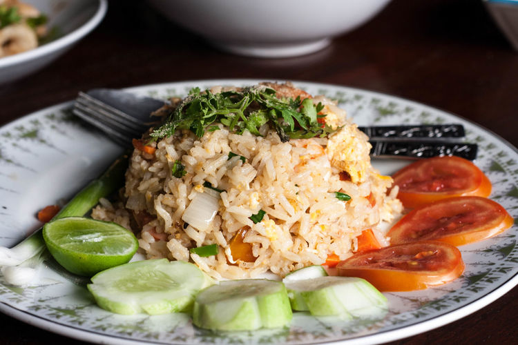 Asian Food Chinese Food Close-up Eating Utensil Food Food And Drink Freshness Fruit Healthy Eating High Angle View Indoors  Kitchen Utensil Meal No People Plate Ready-to-eat Rice Rice - Food Staple Spoon Vegetable Wellbeing White Meat