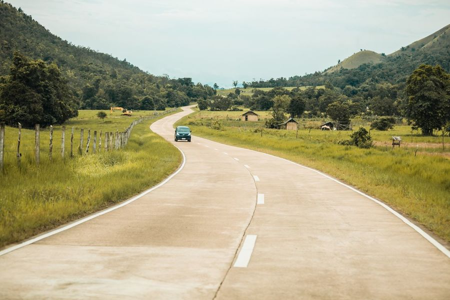 On the road. Road Transportation The Way Forward Tree Landscape Day Grass No People Tranquil Scene Nature Sky Scenics Outdoors Beauty In Nature Tranquility Mountain Winding Road Car Driving Green Philippines Coron, Palawan