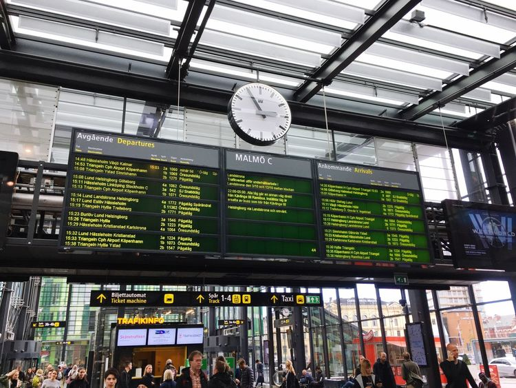Large Group Of People Clock Time Travel Indoors  Crowd Railroad Station Men Arrival Departure Board Real People Public Transportation People Day Malmö Sweden Traveling Home For The Holidays