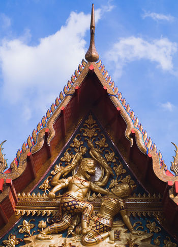 Close up of old thai art at the temple roof in the morning with beautiful blue sky. Golden Roof Rooftop Statue Architecture Building Exterior Built Structure Cloud - Sky Day Gold Colored History Low Angle View No People Old Old Buildings Ornate Outdoors Place Of Worship Religion Sculpture Sculptures Sky Spirituality Statue Travel Destinations