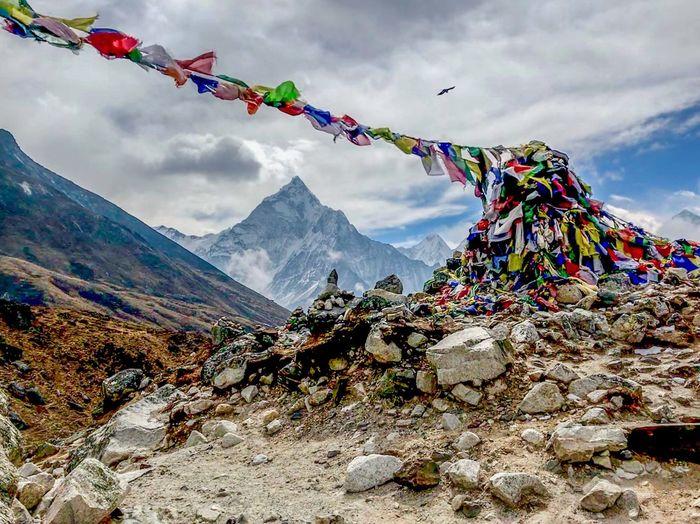 Everest Base Camp Trek Nepal - prayer flags flying at the entrance to Khumbu glacier valley Cloud - Sky Flag Mountain Mountain Peak Mountain Range Multi Colored Religion Scenics - Nature