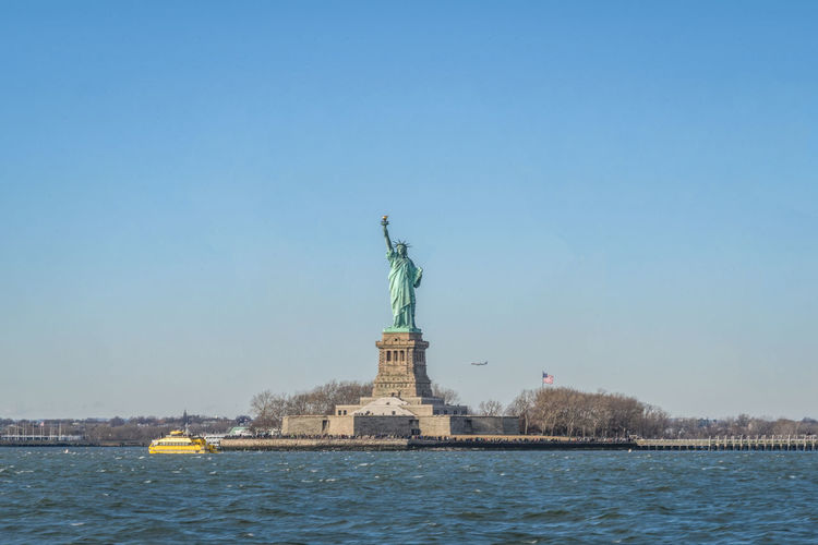 Clear Sky Cultures Day Female Likeness Human Representation New Life New York New York City No People Outdoors Sculpture Sea Sky Statue Statue Of Liberty Travel Destinations Water