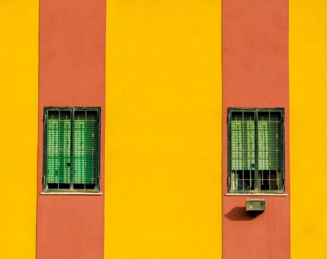 Architecture Backgrounds Building Building Exterior Built Structure City Day Full Frame Glass - Material House Multi Colored No People Orange Color Outdoors Red Reflection Side By Side Wall - Building Feature Window Windows Yellow EyeEmNewHere Adventures In The City The Architect - 2018 EyeEm Awards