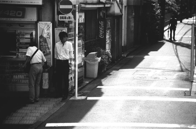 Area Blackandwhite City City Life Day Film Film Photography Japan Japanese  Lifestyles Light And Shadow Men Real People Rexaling Road Sidewalk Smoking Street Streetphotography Tokyo Urban Battle Of The Cities People And Places Monochrome Photography Snap A Stranger