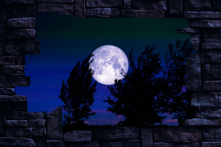 Scenic view of moon against blue sky at night