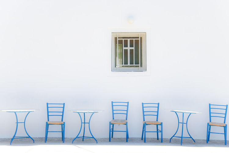 While waiting for you... Greece Photos Quiet Architecture Blue Building Exterior Built Structure Chair Day Furniture Greece No People Seat Table Wall White Color Window #urbanana: The Urban Playground