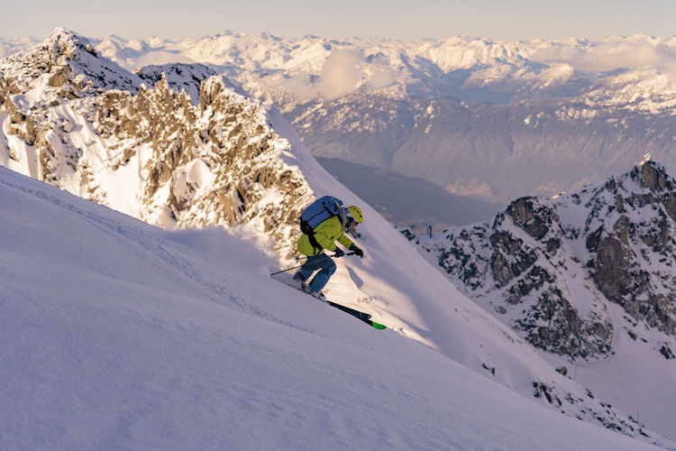 Man Skiing On Snowcapped Mountains