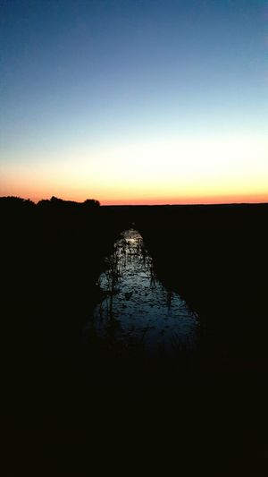 When the sun goes down Sunset Water Dark Nature Beauty In Nature Horizon No People Outdoors Non-urban Scene Clear Sky Horizon Over Land Canal