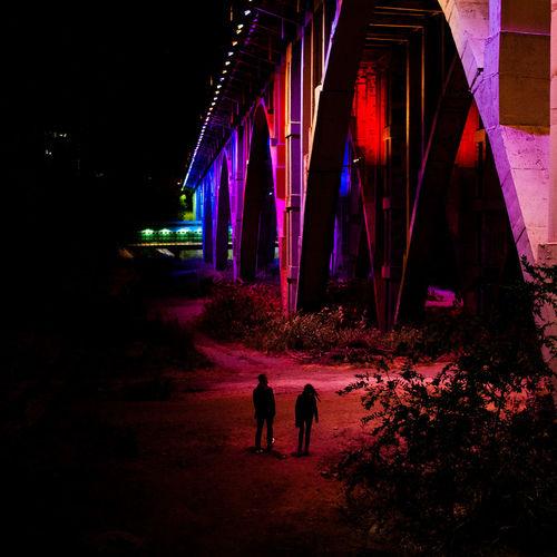 Silhouette people at illuminated night