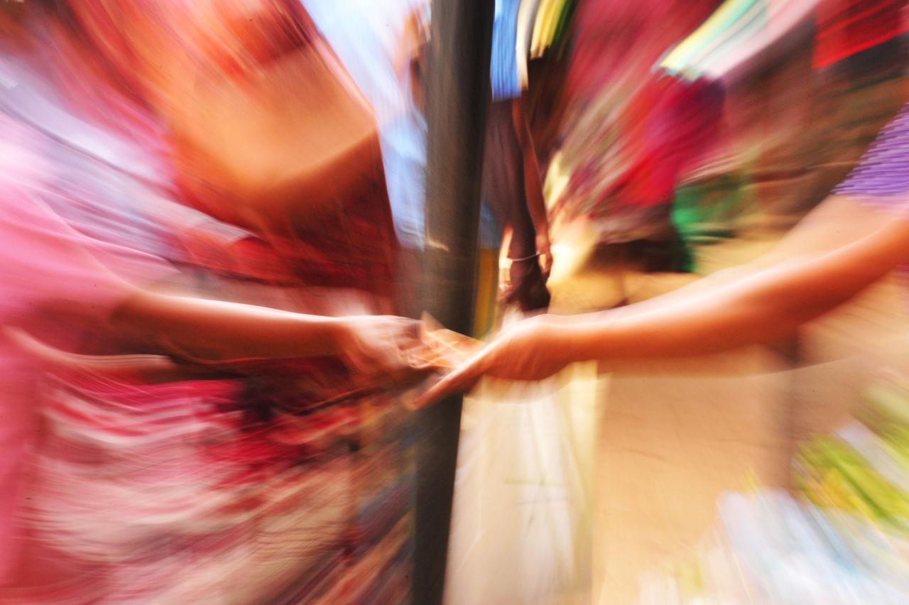 BLURRED MOTION OF WOMEN STANDING IN NIGHTCLUB