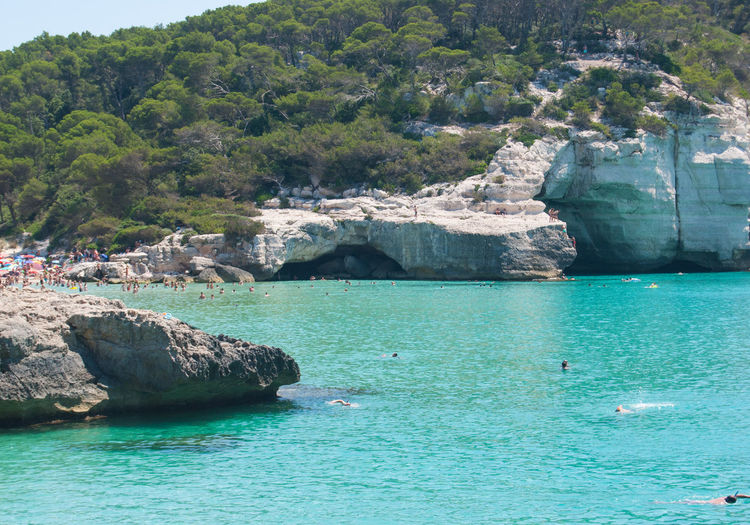 Cala Mitjana SPAIN Bay Beauty In Nature Day Holiday Incidental People Island Land Menorca Mountain Nature Outdoors Plant Rock Rock - Object Scenics - Nature Sea Solid Tranquil Scene Tranquility Tree Turquoise Colored Water Waterfront