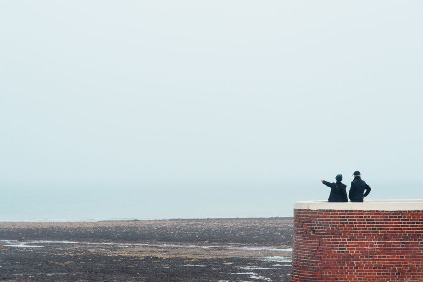 Couple Couple - Relationship Real People Watching Looking Away Panorama Observing Observation Point Landscape Seascape Sea Ocean Beach Two People Sky Copy Space Water Nature Day Horizon Over Water Horizon Men Standing Leisure Activity Scenics - Nature Outdoors Coast Friend Calm Countryside