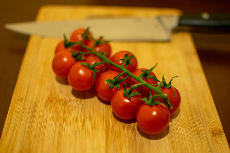 High angle view of cherry tomatoes on cutting board