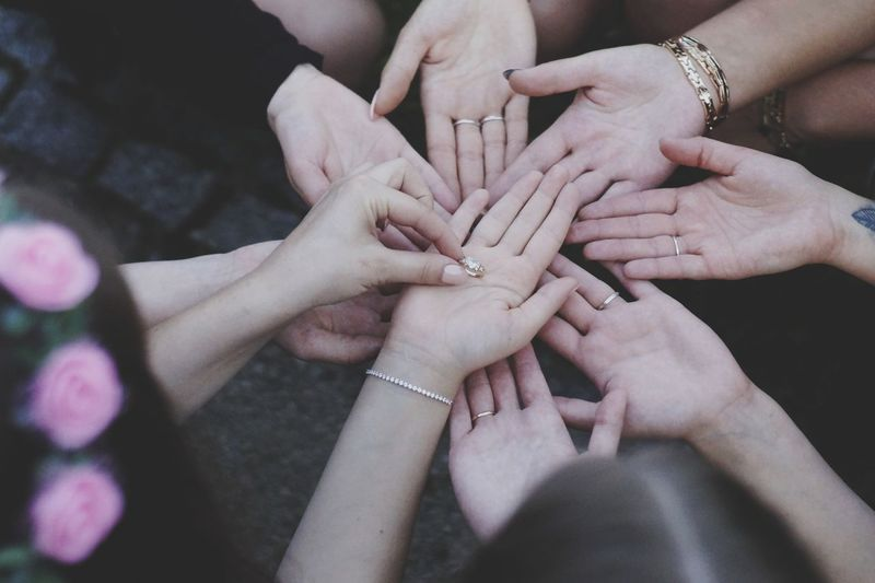 High angle view of people hands
