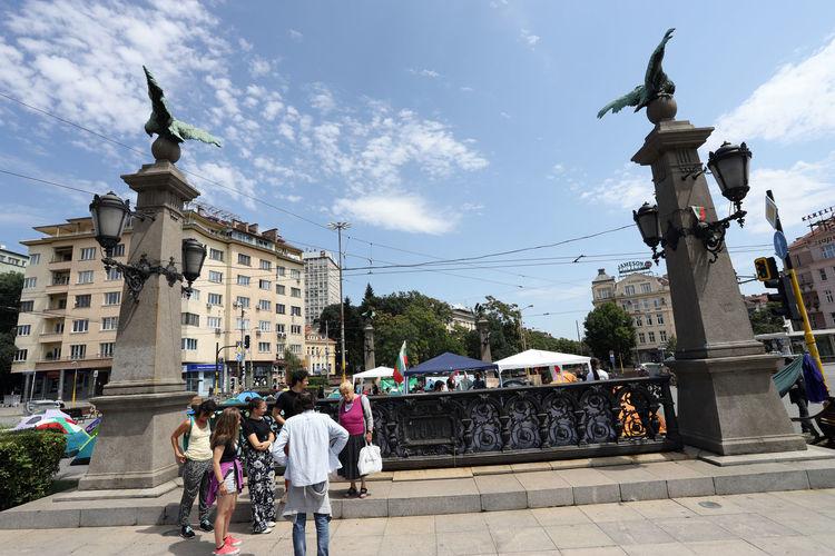People standing against buildings in city