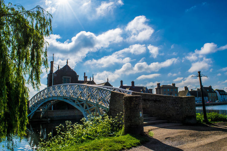 Arch bridge over canal on sunny day