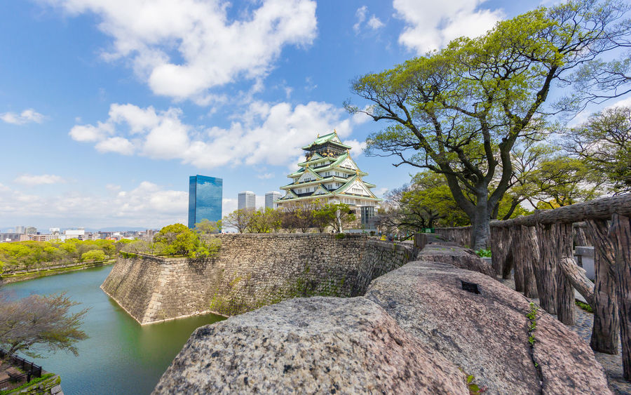 Osaka castle in blue sky Ancient Civilization Architecture Beauty In Nature Building Building Exterior Built Structure Castle Cityscape Cloud - Sky Cultures Day Destination History Kansai Landmark Nature No People Old Ruin Outdoors Sky Tree Water