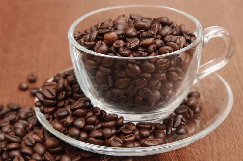 Close-up of coffee beans in glass on table