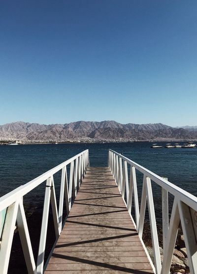 Water Sky Clear Sky Railing Sea Nature Tranquility Tranquil Scene Pier Mountain The Way Forward Day No People Built Structure Scenics - Nature Outdoors Direction