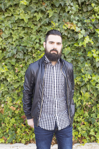 Beard Man Hipster Males  Portrait Young Adult Fashion Hairstyle Backgrounds Cool Casual Clothing Retro Styled Adult Attractive Vintage Flowers Fashionable Stylish Beauty In Nature Facial Hair Lifestyles Men Style Stranding Handsome