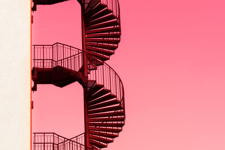Stairs Architecture Building Exterior Built Structure Clear Sky Copy Space Day Fire Escape Go-west-photography.com Low Angle View Metal Nature No People Outdoors Railing Red Sky Spiral Spiral Staircase Stair Staircase Steps And Staircases Wall - Building Feature