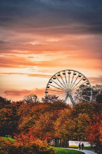 EyeEm Selects Ferris Wheel Amusement Park Tree Orange Color Arts Culture And Entertainment Sunset Sky Nature Amusement Park Ride Big Wheel Beauty In Nature Outdoors Day Riesenrad Kirmes Volksfest Spaß Am Leben  Fun first eyeem photo