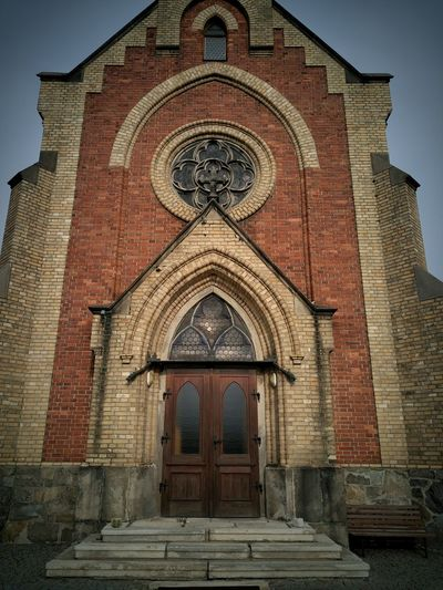 Architecture Building Exterior Built Structure Façade Place Of Worship Entrance Door Religion Spirituality Brick Wall Church Closed Arch Sky Outdoors History Red Day Entryway Tall - High