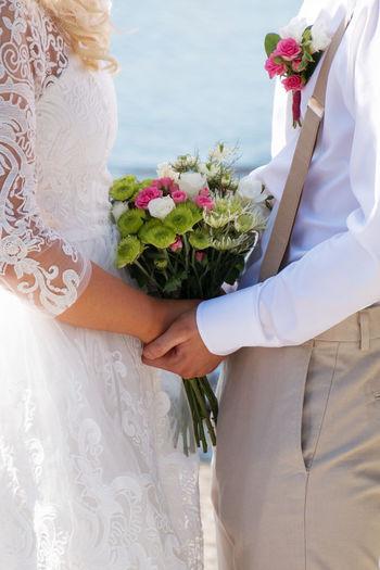 Bouquet Bretelle Bride And Groom Bunch Of Flowers Flower Flower Arrangement Freshness Garter Holding Holding Hands Low Section Wedding