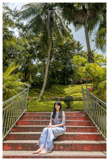 Myanmar dress with me Sitting Young Women One Person Women Young Adult Only Women Tree Day Outdoors One Young Woman Only Smiling Nature Sky Adults Only Adult Full Length Myanmar Pagoda Shine Bright People Relaxation One Woman Only