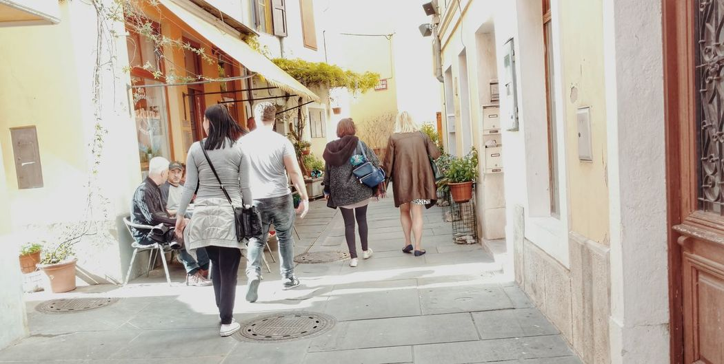 Tourists. Izola Izola- Slovenia Slovenia Istria Travel Traveling Travel Destinations Orange Wine Spring My Favorite Photo The Architect - 2016 EyeEm Awards Architecture People Storytelling EyeEm Gallery Showcase:may Streetphotography Check This Out Outdoors EyeEm Best Edits The Street Photographer - 2016 EyeEm Awards The Storyteller - 2016 Eyeem Awards The Great Outdoors - 2016 EyeEm Awards